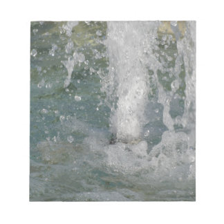 Splashes of fountain water in a sunny day notepad