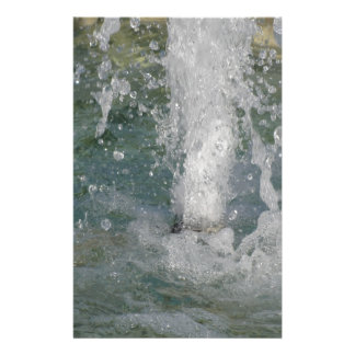 Splashes of fountain water in a sunny day stationery