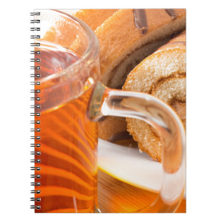 Sponge cake with chocolate filling and tea notebook