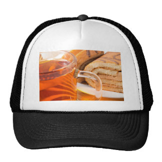 Sponge cake with chocolate filling and tea trucker hat
