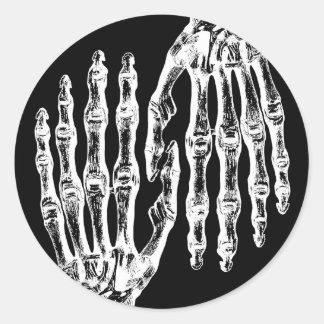 Spooky skeletal hand classic round sticker