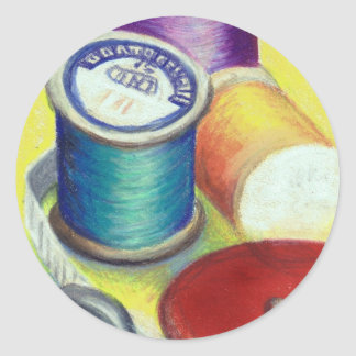 Spools of thread - colored pencil drawing round sticker
