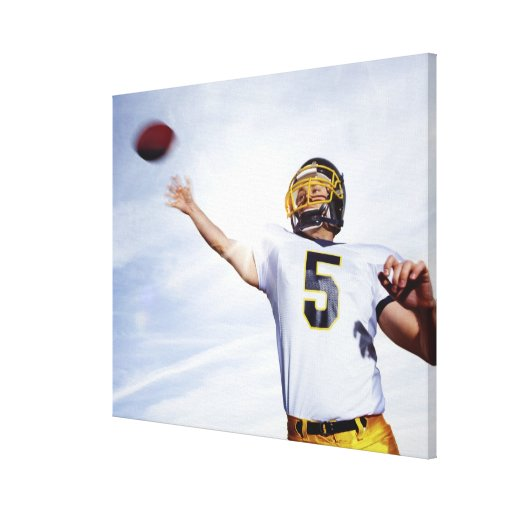 sportsman playing with rugby ball stretched canvas print