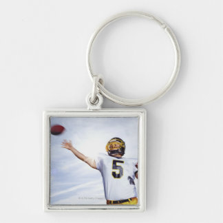 sportsman playing with rugby ball Silver-Colored square keychain