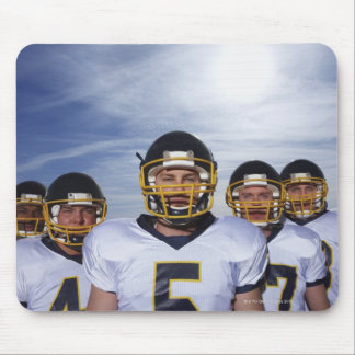 sportsmen standing together with sky in mouse pad