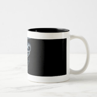 Spotlight on a medical caduceus Two-Tone coffee mug