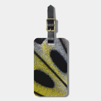Spotted and yellow butterfly wing luggage tag