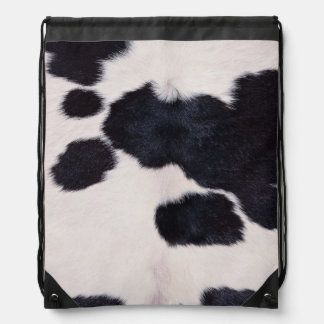 SPOTTED COW HIDE CINCH BAGS