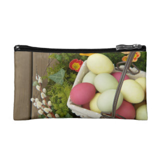 Spring Flowers and Basket of Easter Eggs Makeup Bags