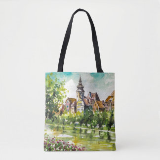 Spring in small city on the river tote bag