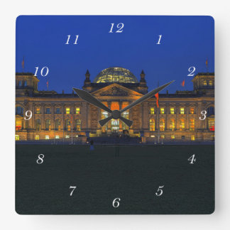 Square clock Berlin Reichstag in the evening