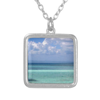 Square necklace with a photo of the Belize coastli