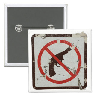 Square pin with old sign with graphic no guns