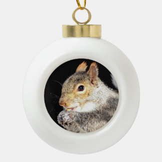 Squirrel eating a nut ceramic ball christmas ornament