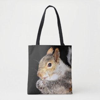 Squirrel eating a nut tote bag