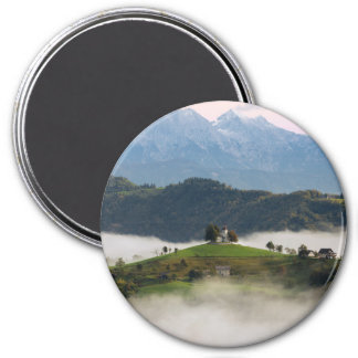 St. Thomas church with mountains in Slovenia round Magnet