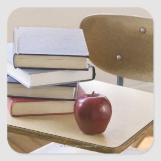 Stack of books, apple, and school desk square sticker