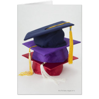 Stack of graduation mortarboards card