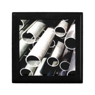 stack of metal tubes gift box