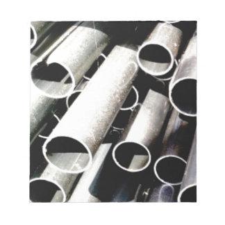 stack of metal tubes notepad