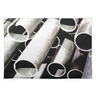 stack of metal tubes placemat