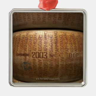 Stack of parmesan cheeses, close-up metal ornament