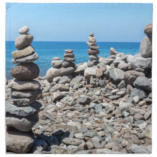 Stacked beach stones at blue sea napkin