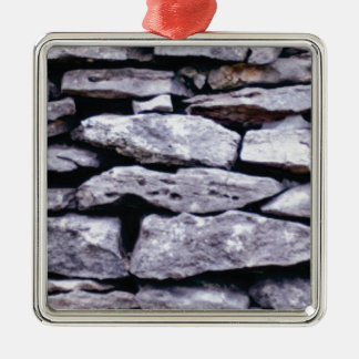 stacked rock wall metal ornament