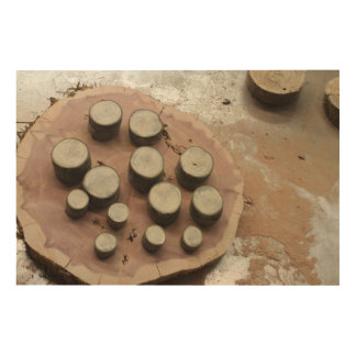 Stacks of Wood Slices of Many Sizes with Sawdust Wood Wall Art