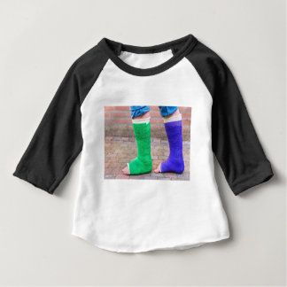 Standing child with two colorful gypsum legs baby T-Shirt