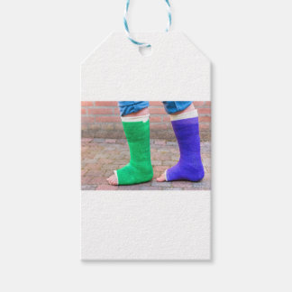 Standing child with two colorful gypsum legs gift tags
