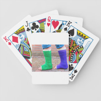 Standing child with two colorful gypsum legs poker deck