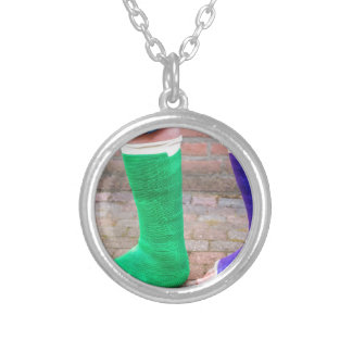 Standing child with two colorful gypsum legs silver plated necklace