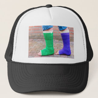 Standing child with two colorful gypsum legs trucker hat