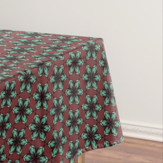 Star flower kaleidoscope on deep red brown tablecloth