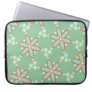 Star flowers with retro spots on pastel green laptop sleeve