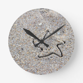 Star Shape Created in the Sand Round Clock
