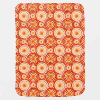 Starbursts and pinwheels, mandarin orange receiving blanket