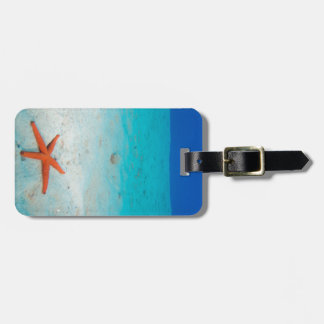 Starfish on a sand dune underwater luggage tag