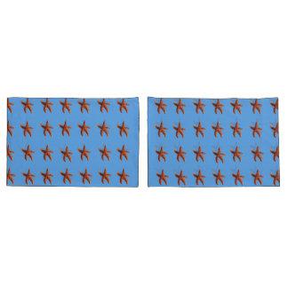 Starfish or sea stars on blue pillowcase