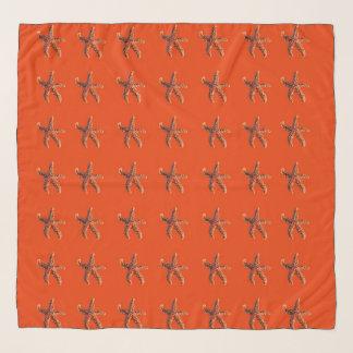 Starfish or sea stars on red scarf