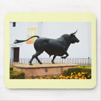 Statue of a bull mouse pad