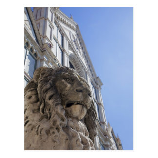 statue of a lion with the facade of Santa Croce Postcard