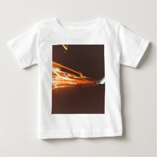Steel tool on a grinder with sparks baby T-Shirt