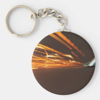 Steel tool on a grinder with sparks keychain
