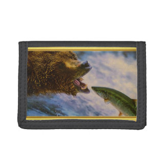 Steelhead salmon jumping into grizzly bears mouth tri-fold wallet
