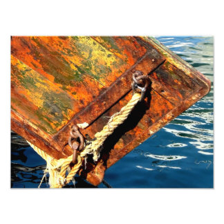 Stern of fishing boat and reflections in the port photo print