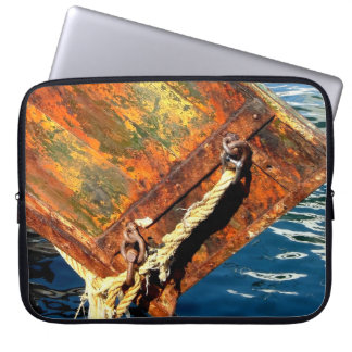 Stern of fishing boat and reflections in the water laptop computer sleeve