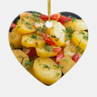 Stew of potatoes with onion, bell pepper and dill ceramic heart ornament