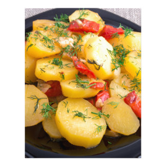Stew of potatoes with onion, bell pepper and dill letterhead